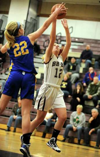 Emily Pearce of Burnt Hills is guarded by Jillian Davis of Queensbury as she drives to the basket du