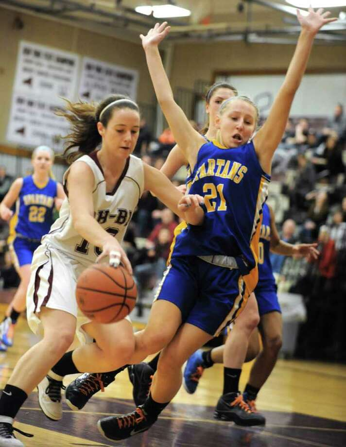 Morgan Esperti of Burnt Hills drives to the basket against Aisling McAllister of Queensbury during a basketball game Wednesday, Feb. 22, 2012 in Burnt Hills, N.Y.  (Lori Van Buren / Times Union) Photo: Lori Van Buren