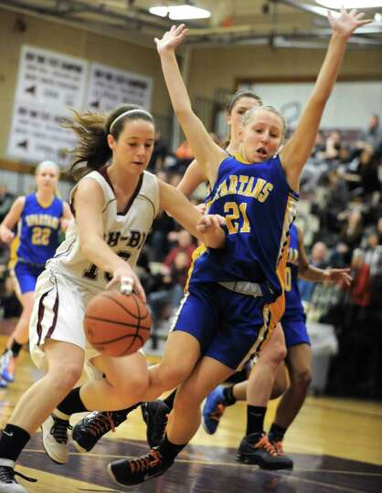 Morgan Esperti of Burnt Hills drives to the basket against Aisling McAllister of Queensbury during a