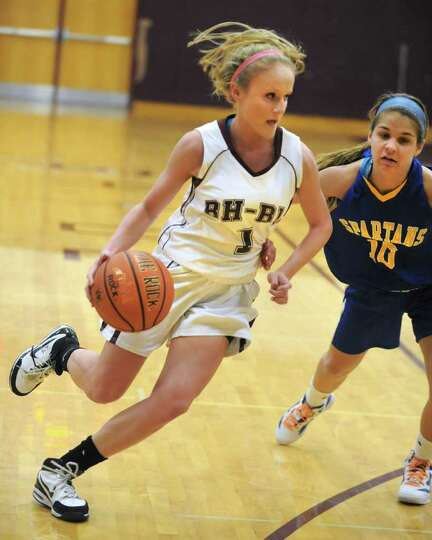 Kaita Albanese of Burnt Hills drives to the basket during a basketball game against Queensbury Wedne