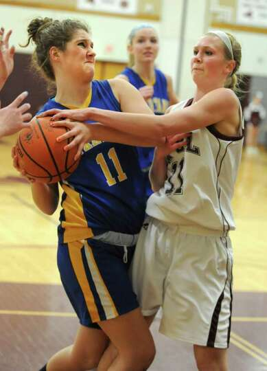 From left, Jamie McLaughlin of Queensbury and Elisabeth Morton of Burnt Hills battle for the ball du