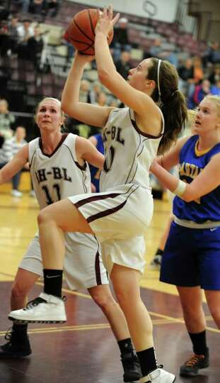 Morgan Esperti of Burnt Hills drives to the basket during a basketball game against Queensbury Wedne