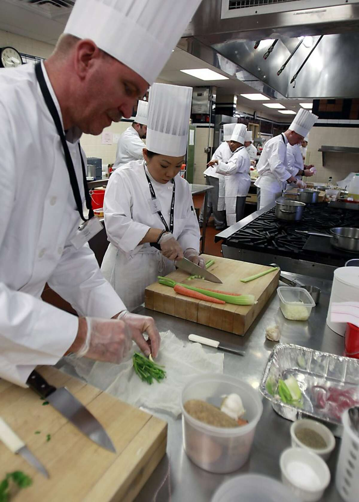 Mark Engelsman, left, and Sandra Lee of the Wounded Warrior Project prepare a recipe during culinary bootcamp at the Culinary Institute of America in Hyde Park, N.Y., on Wednesday, Feb. 15, 2012. (AP Photo/Mike Groll)