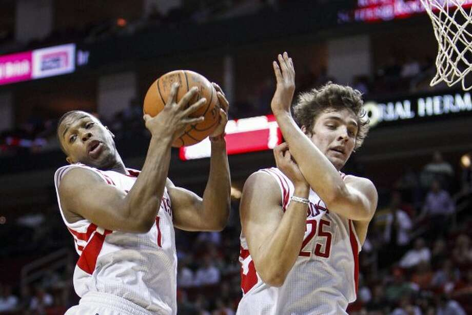 Rockets point guard Kyle Lowry (7) and forward Chandler Parsons (25) go for a rebound during the first half. (Michael Paulsen / Houston Chronicle)