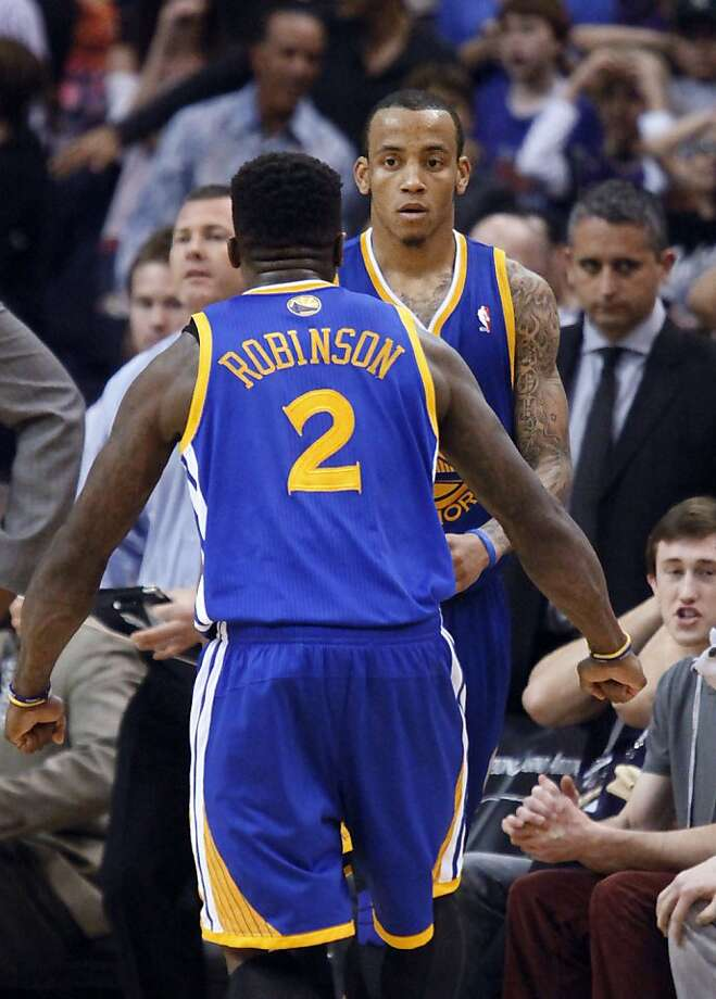 Golden State Warriors guard Monta Ellis, rear, is congratulated by  Nate Robinson after Ellis hit the game-winning basket against the Phoenix Suns in the fourth quarter of an NBA basketball game Wednesday, Feb. 22, 2012, in Phoenix. The Warriors won 106-104. Photo: Paul Connors, Associated Press