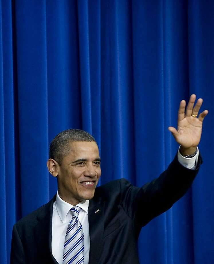US President Barack Obama waves after speaking about the payroll tax cut and unemployment insurance extensions passed by Congress at the Eisenhower Executive Office Building adjacent to the White House in Washington, DC, February 21, 2012. AFP PHOTO / Saul LOEB (Photo credit should read SAUL LOEB/AFP/Getty Images) Photo: Saul Loeb, AFP/Getty Images