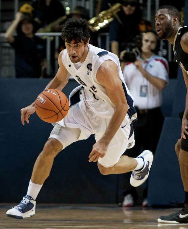 Rice Owls forward Arsalan Kazemi chases after a loose ball during the second half of the NCAA basketball game between the Rice Owls and the UCF Knights at Tudor Fieldhouse on Wednesday, Feb. 22, 2012, in Houston.  Rice defeated UCF 83-74 as Owls head coach Ben Braun recorded his 600th career win. Photo: Andrew Richardson, Houston Chronicle / © 2012 Andrew Richardson