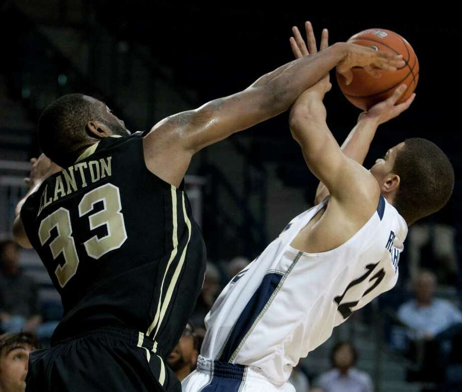 Rice Owls forward Jarelle Reischel, right, is fouled by UCF Knights forward Keith Clanton, left, during the second half of the NCAA basketball game between the Rice Owls and the UCF Knights at Tudor Fieldhouse on Wednesday, Feb. 22, 2012, in Houston.  Rice defeated UCF 83-74 as Owls head coach Ben Braun recorded his 600th career win. Photo: Andrew Richardson, Houston Chronicle / © 2012 Andrew Richardson