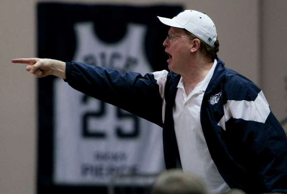 An Owls fan yells at a referee during the second half of the NCAA basketball game between the Rice Owls and the UCF Knights at Tudor Fieldhouse on Wednesday, Feb. 22, 2012, in Houston.  Rice defeated UCF 83-74 as Owls head coach Ben Braun recorded his 600th career win. Photo: Andrew Richardson, Houston Chronicle / © 2012 Andrew Richardson
