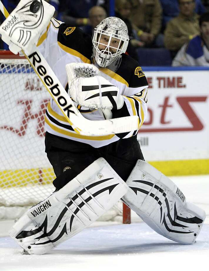 Boston Bruins goalie Tim Thomas (30) makes a blocker save in the second period of an NHL hockey game against the St. Louis Blues, Wednesday, Feb. 22, 2012 in St. Louis. (AP Photo/Tom Gannam) Photo: Tom Gannam, Associated Press