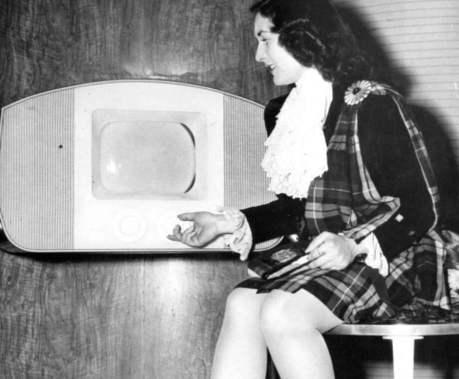 Oct. 5, 1947: This Ferranti television sells for $550, which in 1947 could buy you the state of North Dakota. The model has a Dianne Feinstein thing going on. (World Wide Photo)