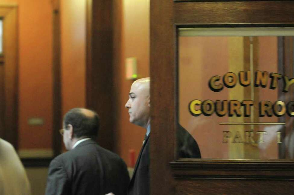 Attorney James Long, left, and his client William McInerney leave Rensselaer County Court following a delay in the Troy ballot fraud case on Thursday, Feb. 23, 2012 in Troy, NY. McInerney is the former Troy City Clerk and will testify for the prosecution in the case. (Paul Buckowski / Times Union)