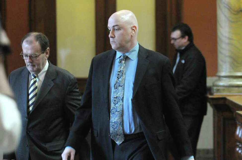 Attorney James Long, left, and his client William McInerney leave Rensselaer County Court following a delay in the Troy ballot fraud case on Thursday, Feb. 23, 2012 in Troy, NY. (Paul Buckowski / Times Union archive)
