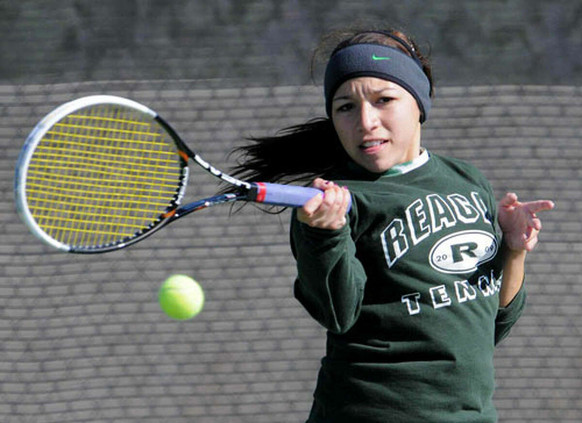 Reagan's Christina Lopez hits a forehand during the girls' singles championship match of the NEISD tournament Feb. 11. Lopez won the singles bracket and is one of the favorites to advance to the state Class 5A tournament in Austin at the end of April. John Albright / North Central News
