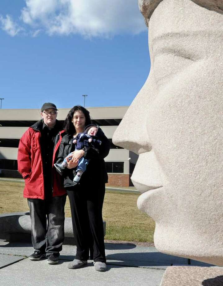 Anthony Russo and his fiancee, Cristy Cacciotti-Fortunato, hold their 2-month-old baby Jason as they pose for a photograph outside the Stamford Superior Court on Thursday, February 23, 2012. Photo: Lindsay Niegelberg / Stamford Advocate