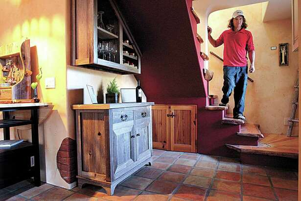 Ted Fehn's home in Santa Cruz, California, is filled with wood art and furniture, much of it from found wood.