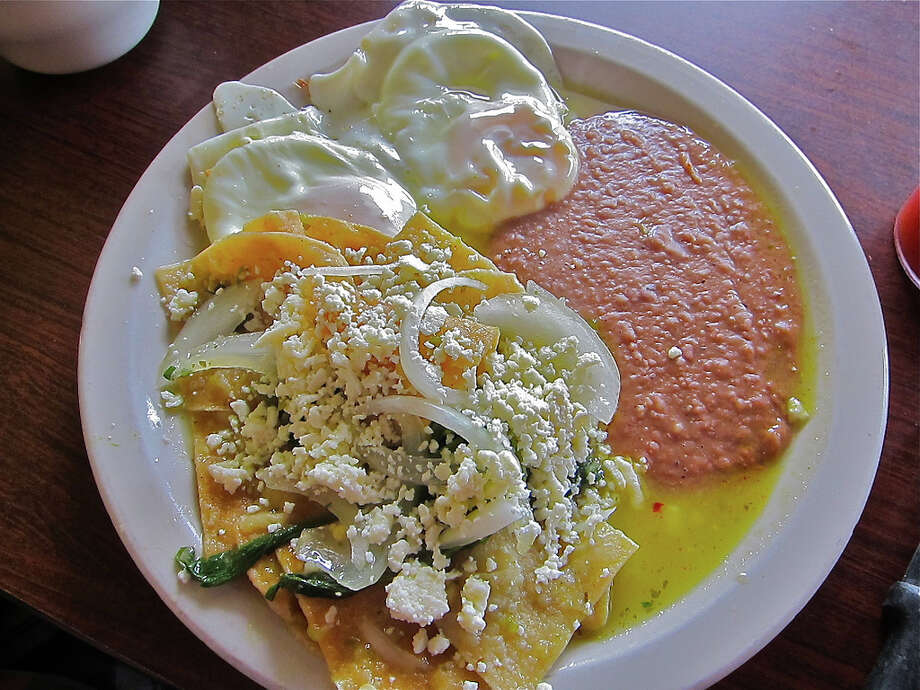 Chilaquiles verdes with eggs over easy at La Guadalupana Photo: Alison Cook