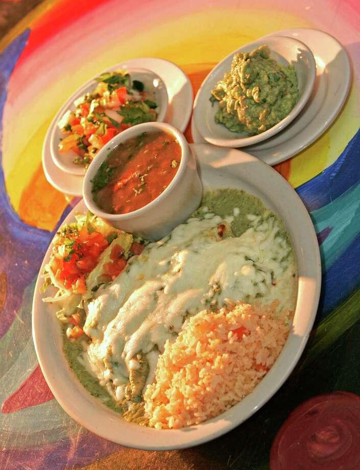 Enchiladas Teresitas with guacamole salsa and beans at Romero's Las Brazas Photo: Craig H. Hartley / Freelance
