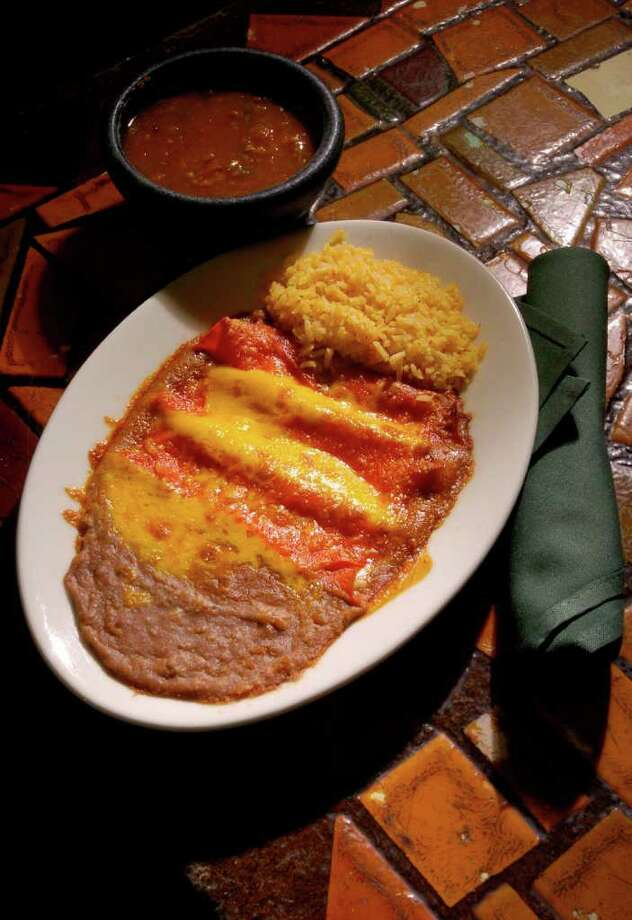 A cheese enchilada plate at Spanish Village Photo: Christobal Perez / Houston Chronicle