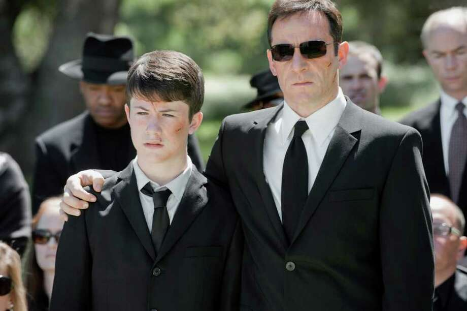 In NBC's ''Awake', Jason Isaacs (right) plays police detective Michael Britten, who, after a terrible accident, vacillates between two 'realities' brought on by dreams, one that has his son Rex (Dylan Minnette, left) still alive, the other, featuring his beloved wife. Photo: Lewis Jacobs, Lewis Jacobs/NBC / © NBCUniversal, Inc.