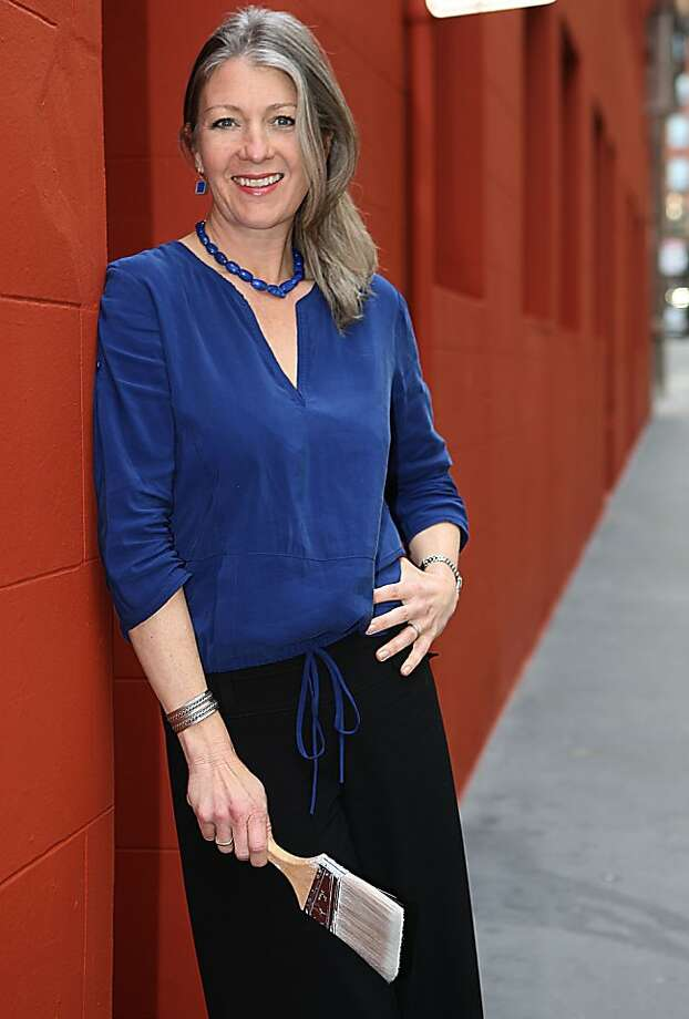 New executive director Anthea Hartig of the California Historical Society in San Francisco, Calif., in the alley of her building on Tuesday, February 21, 2011.  She is painting the society building international orange to mark the opening of an exhibition honoring the 75th anniversary of the Golden Gate Bridge. Photo: Liz Hafalia, The Chronicle