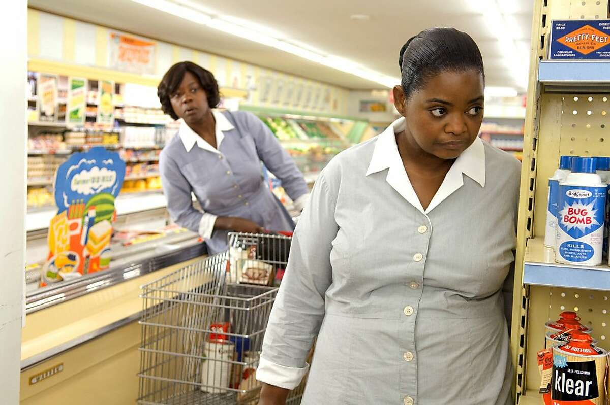 """In this film publicity image released by Disney, Octavia Spencer, right, and Viola Davis are shown in a scene from """"The Help."""""""