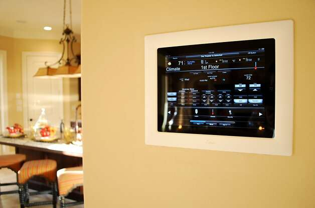 Crestron iPad controller in kitchen Photo: Crestron