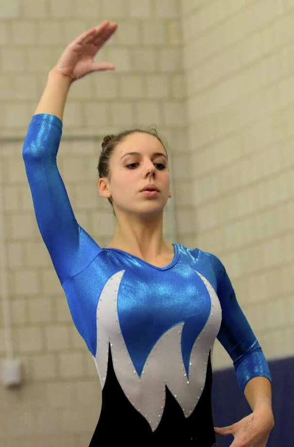 Staples' Anna Violette warms up at a meet Dec. 22. Violette had an all-around score of 35.25 last Friday, and will be competing at the Class L championships tomorrow (Feb. 25) at Pomperaug. Photo: Amy Mortensen, Amy Mortensen / For The Westport News / Connecticut Post Freelance