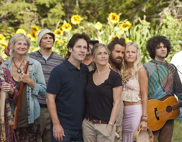"(L to R, foreground) Kathy (KERRI KENNEY-SILVER), George (PAUL RUDD), Linda (JENNIFER ANISTON), Seth (JUSTIN THEROUX) and Eva (MALIN AKERMAN) at Elysium in ""Wanderlust"", the raucous new comedy from director David Wain and producer Judd Apatow about a harried couple who leave the pressures of the big city and join a freewheeling community where the only rule is to be yourself. Photo: Gemma La Mana, Universal Pictures"