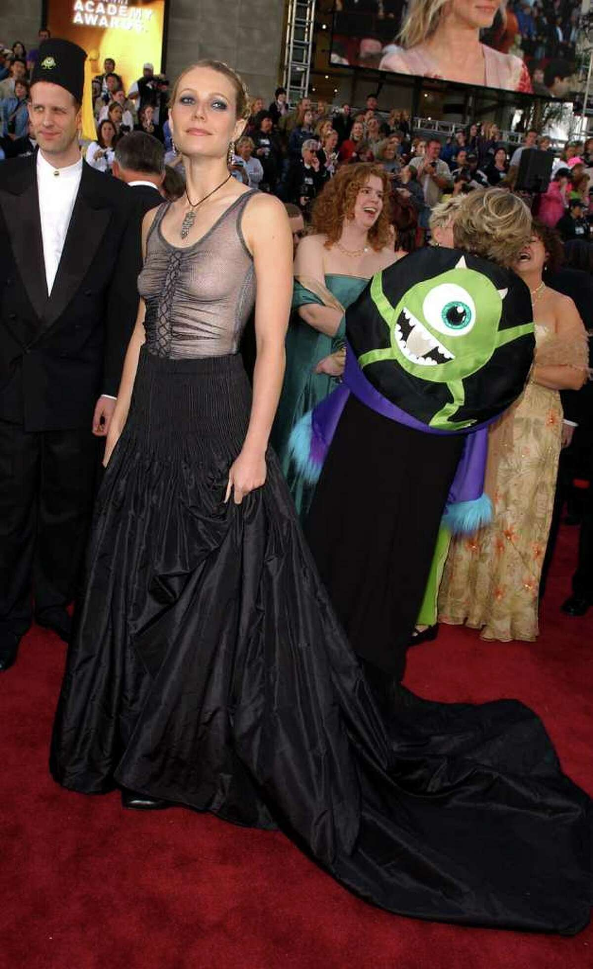 9. Gwyneth Paltrow, 2002 Love her or mostly hate her, Paltrow arrived at the Oscars in a see-through Christian Lacroix Goth-inspired number that left her boobs lopsided. Girlfriend, a bra would have been a good idea.