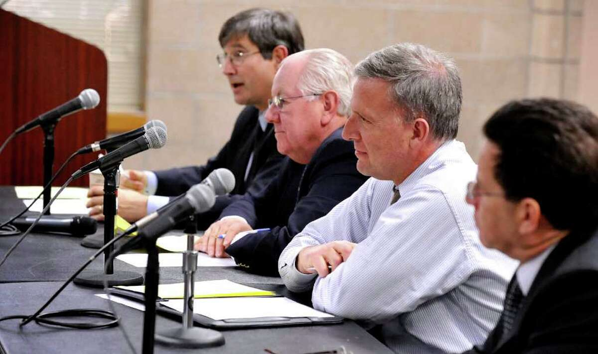 Some members of the White Street Task Force, including from left, Paul Reis, Wayne Shepperd, Steve Rosentel and Paul Steinmetz, listen to a speaker blaming the third lane for increasing the danger for pedestrians crossing White Street in Danbury. The public hearing was held at the Western Connecticut State University's midtown campus Thursday, Feb. 23, 2012.