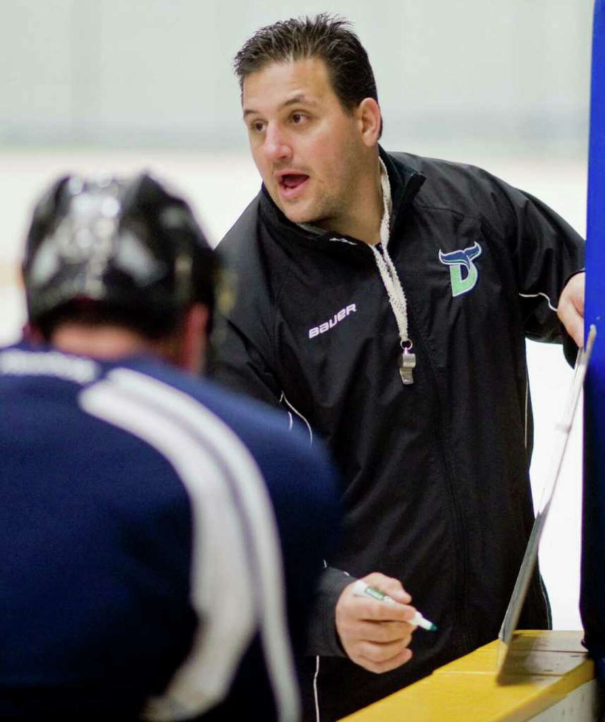 Whalers head coach Phil Esposito outlines a drill during a team practice in the Danbury Ice Arena. Wednesday, Oct. 19, 2011