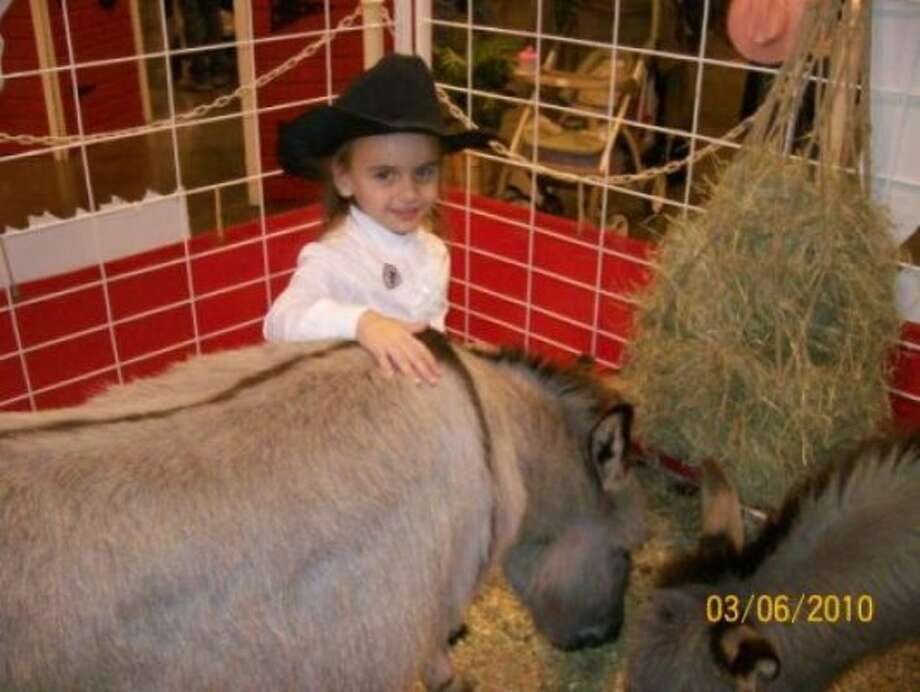 Gracie with her friend, the Donkey. (ThePrincipal / chron.com)