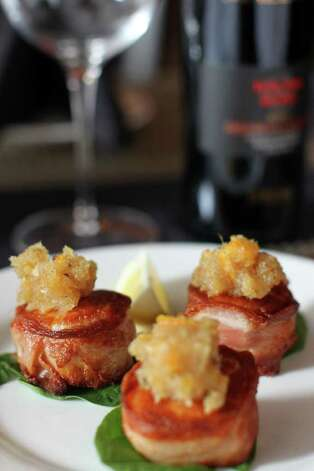 Prosciutto wrapped scallops with orange marmalade at Toscana, Wednesday, February 22, 2012. Photo: JENNIFER WHITNEY / special to the Express-News