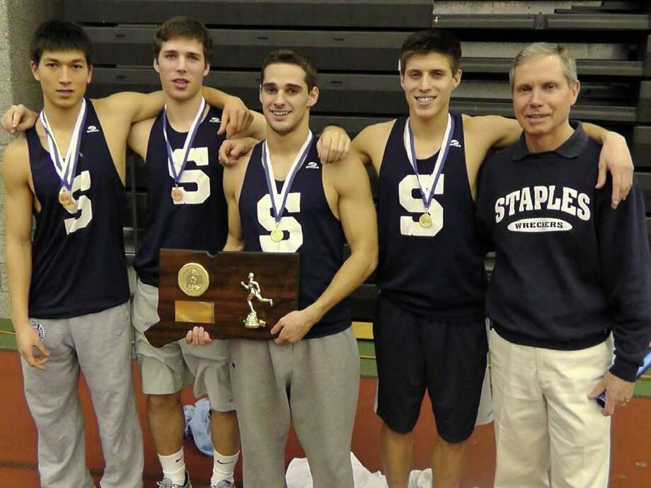 From left, Staples senior captains Zach Mitchell, Kyle Hoberman, Jon Heil, Max Hoberman and coach Laddie Lawrence pose with the State Open plaque after winning the State Open title Saturday. Photo: Jeff Mitchell / Contributed Phot