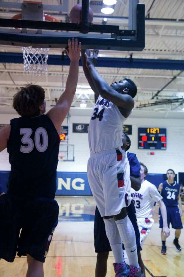GFA's Sean Obi, right, attempts a layup against King Feb. 6. Obi had 10 points and 10 rebounds Wednesday in a 64-62 loss to King in the FAA quarterfinals. Photo: Keelin Daly, Keelin Daly/Staff Photographer / Stamford Advocate
