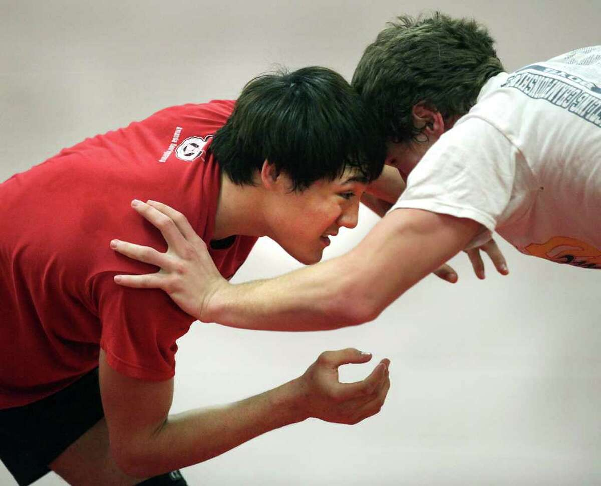 Judson Wrestler Aaron Walker, left, wrestles with team mate Dominic Zaleski preparing for this week's state tournament. Walker hasn't lost a match in two years. He's moved up from the 140-pound weight class to 152 pounds, and is still undefeated. Wednesday, Feb. 22, 2012. Bob Owen/Express-News