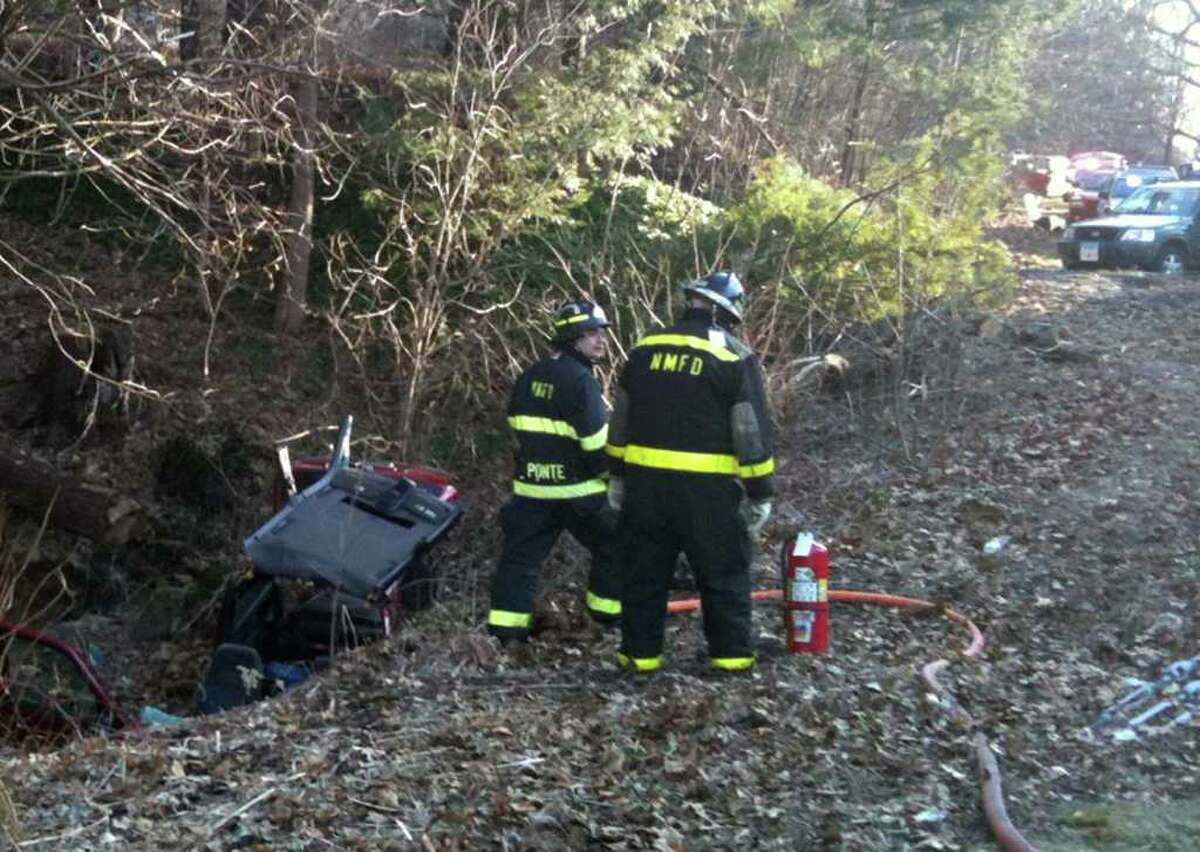 Police and fire crews were called to the scene of a car that went over an embankment on Route 202, north of Hipp Road in New Milford, on Thursday, Feb. 23, 2012. The driver was critically injured.