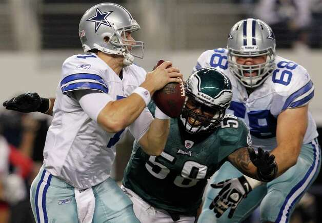 ARLINGTON, TX - DECEMBER 24:  Defensive end Trent Cole #58 of the Philadelphia Eagles beats out offensive tackle Doug Free #68 of the Dallas Cowboys to sack quarterback Stephen McGee #7 of the Dallas Cowboys at Cowboys Stadium on December 24, 2011 in Arlington, Texas. Photo: Tom Pennington, Getty Images / 2011 Getty Images