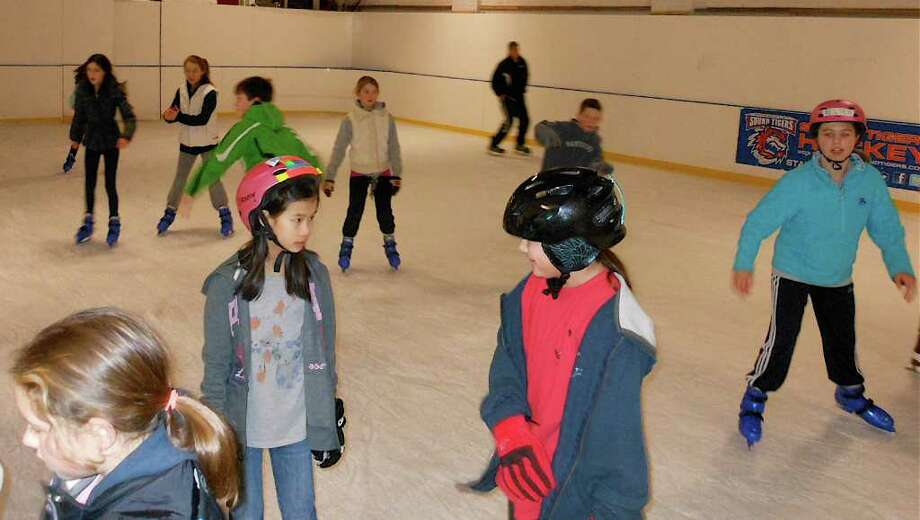 More than 100 youngsters have been skating each day at the Fairfield Ice Academy's rink during the February school vacation, during what has been an unseasonably warm winter. Photo: Mike Lauterborn / Fairfield Citizen contributed