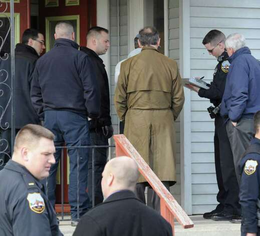 Schenectady County and city law enforcement officials investigate an apparent murder-suicide at 6 Mynderse Street in Schenectady, N.Y. Feb. 23, 2012. (Skip Dickstein / Times Union) Photo: SKIP DICKSTEIN / 2011