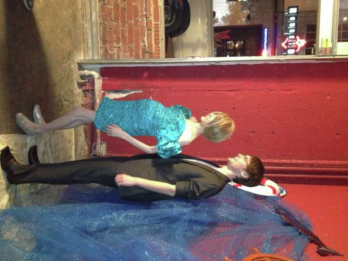 Megan Lindsey and Trey Perry getting their '80s prom photo taken at Dirt Bar on Jan. 18.