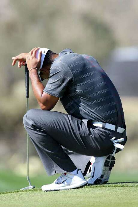 MARANA, AZ - FEBRUARY 23:  Tiger Woods reacts to losing the eighth hole on the eighth green during the second round of the World Golf Championships-Accenture Match Play Championship at the Ritz-Carlton Golf Club  on February 23, 2012 in Marana, Arizona. Photo: Sam Greenwood, Getty Images / 2012 Getty Images