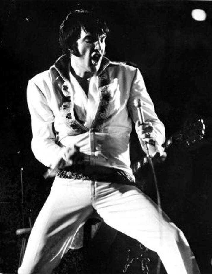 Elvis Presley thrills the crowd at the Astrodome with his 45-minute show at the rodeo on Friday, Feb. 27, 1970. Presley would return to the rodeo stage again in 1974. (Blair Pittman / Houston Chronicle)