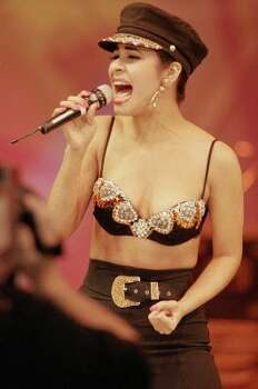 Selena performs with Los Dinos at a 1993 rodeo matinee inside the Astrodome that drew 66,994 people, which set an all-time attendance record at the time. Her 1995 rodeo concert would be her last performance before being fatally shot in Corpus Christi.