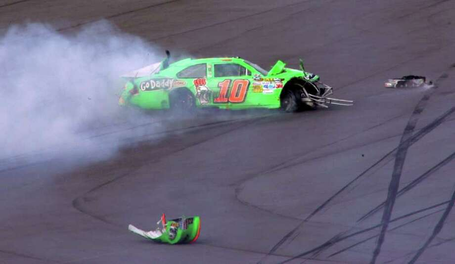 Danica Patrick's car slides down the track after a crash during the first of two NASCAR Daytona Duel 150 qualifying auto races in Daytona Beach, Fla., Thursday, Feb. 23, 2012. Photo: AP