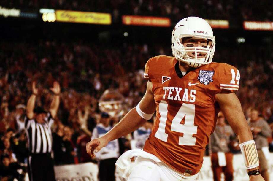 Texas quarterback David Ash celebrates after scoring during the second quarter of the Holiday Bowl NCAA college football game, Wednesday, Dec. 28, 2011, in San Diego. Texas won 21-10. Photo: AP