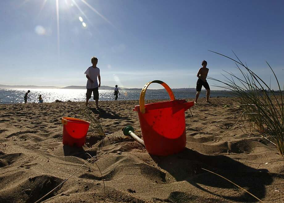 Ben Church and Nicholas Scott spend the afternoon at Crown Beach in Alameda, Calif. on Thursday, Feb. 23, 2012. Warm weather already has sun-worshippers flocking to sandy shorelines. Photo: Paul Chinn, The Chronicle