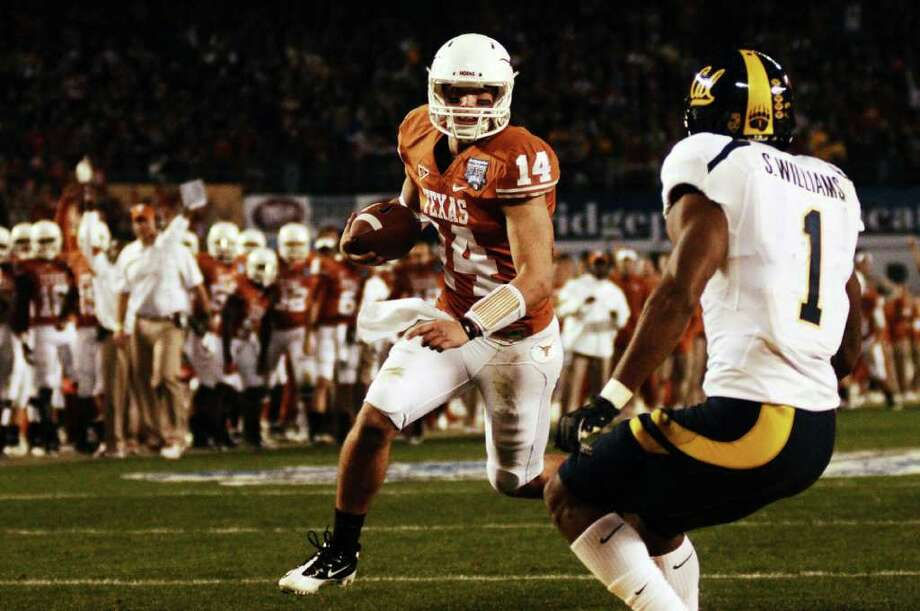 Texas quarterback David Ash runs toward the end zone during the second quarter of the Holiday Bowl NCAA college football game, Wednesday, Dec. 28, 2011, in San Diego. Texas won 21-10. Photo: AP