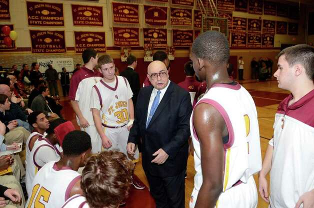 St. Joseph coach Vito Montelli instructs the team as St. Joseph High School hosts Ridgefield High School in varsity boys basketball in Trumbull on Monday. Photo: Shelley Cryan, Shelley Cryan/For The Connecticut Post / Shelley Cryan freelance; CT Post freelance